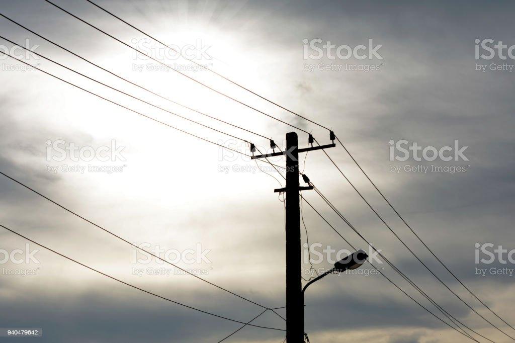 Street light pole on sky background