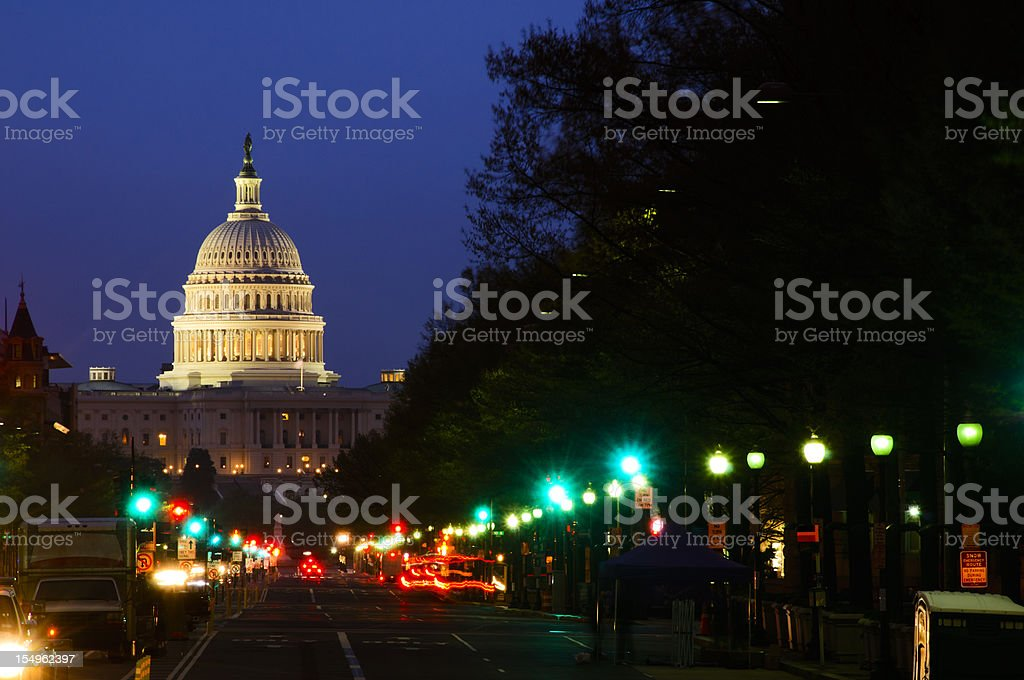 Street lights and US Capitol Building royalty-free stock photo