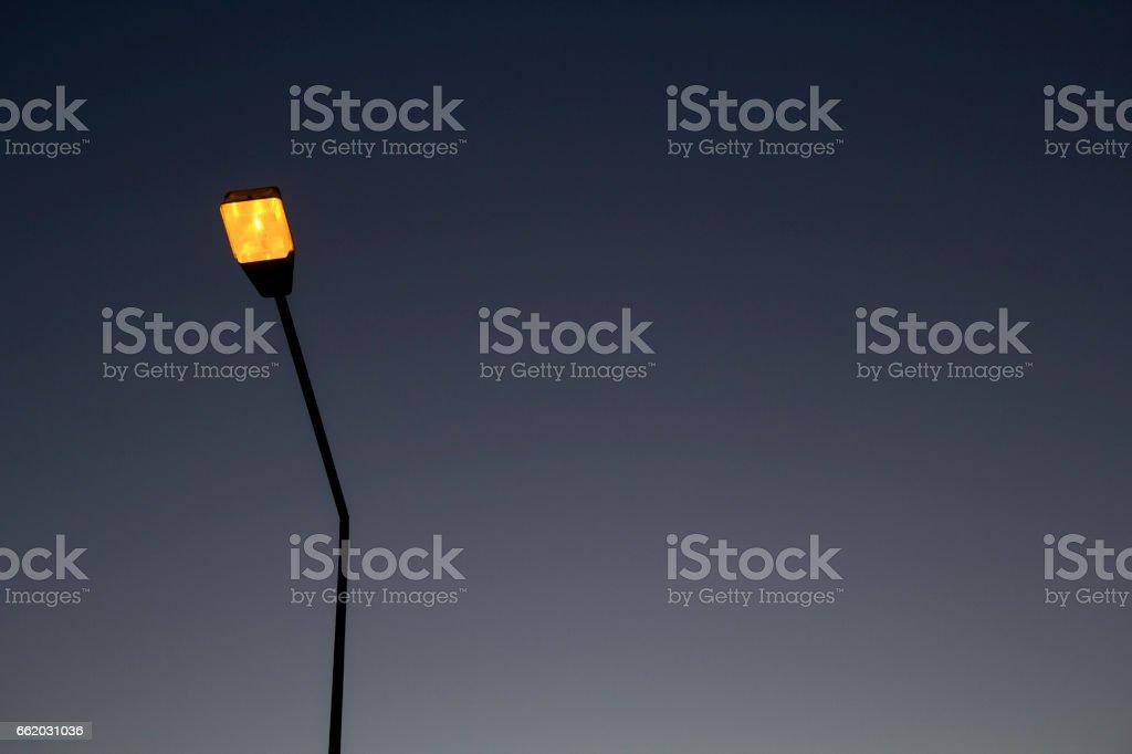 Street lights illuminated, Vintage Style royalty-free stock photo
