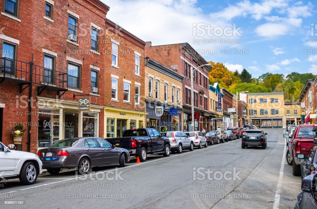 Street Lined with Traditional Brick Buildings with Colourful Shops and Restaurants stock photo