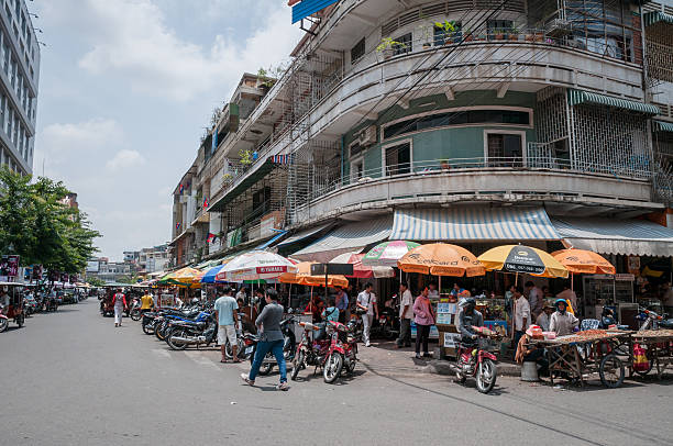 street market in phnom penh, cambodia - motorbike, umbrella stock photos and pictures