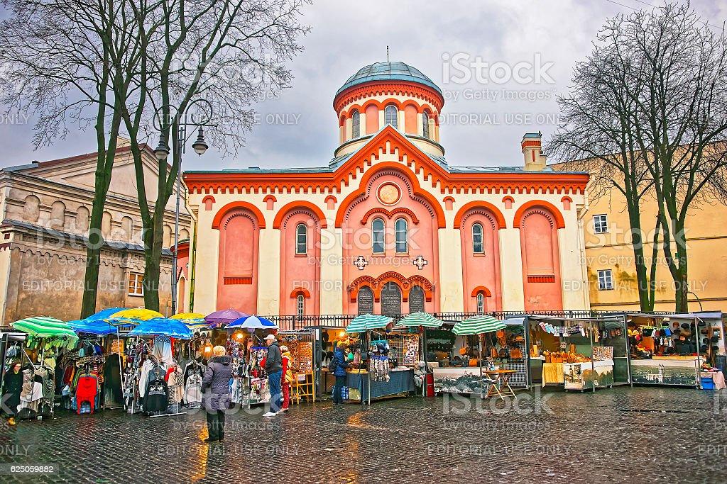 Street market near Church of Saint Paraskeva in Vilnius stock photo