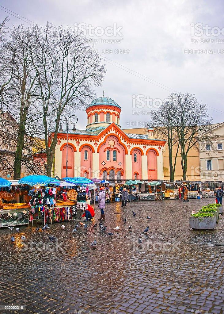 Street market next to Church of Saint Paraskeva in Vilnius stock photo