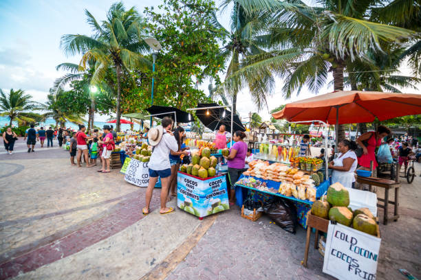 street market on playa del carmen selling gifts, fruits and snacks, mexico - playa del carmen stock photos and pictures