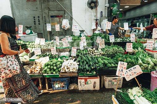 Hong Kong, China - October 18, 2019:  Street market stall with fresh vegetables in Hong Kong, China
