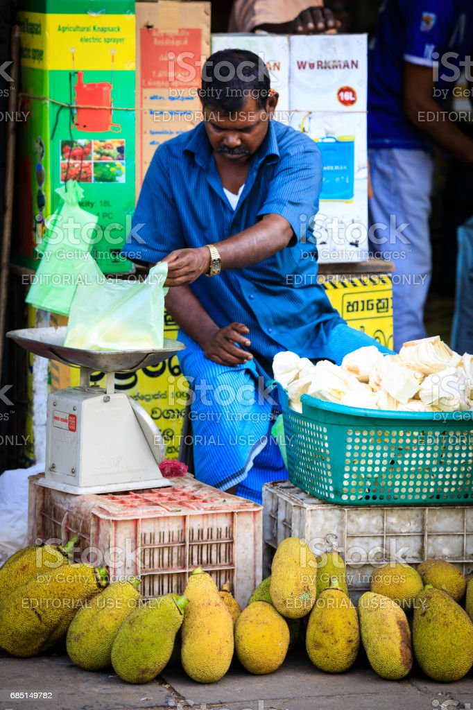 street market vendor of fruits and vegetables in Kandy royalty-free stock photo