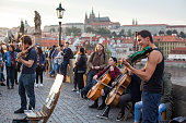 Prague, Czech Republic -  Street music band performing on famous Charles bridge in Prague, Czech Republic