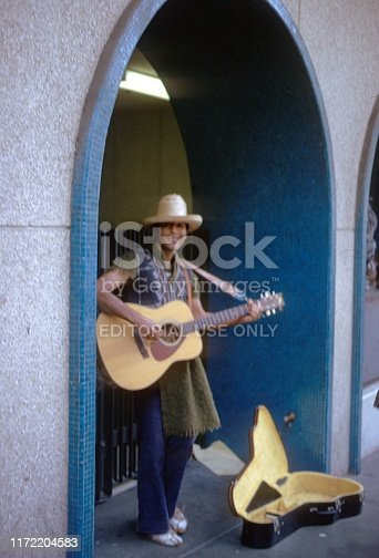 San Francisco, California, USA, 1974. Street musician with guitar in San Francisco.