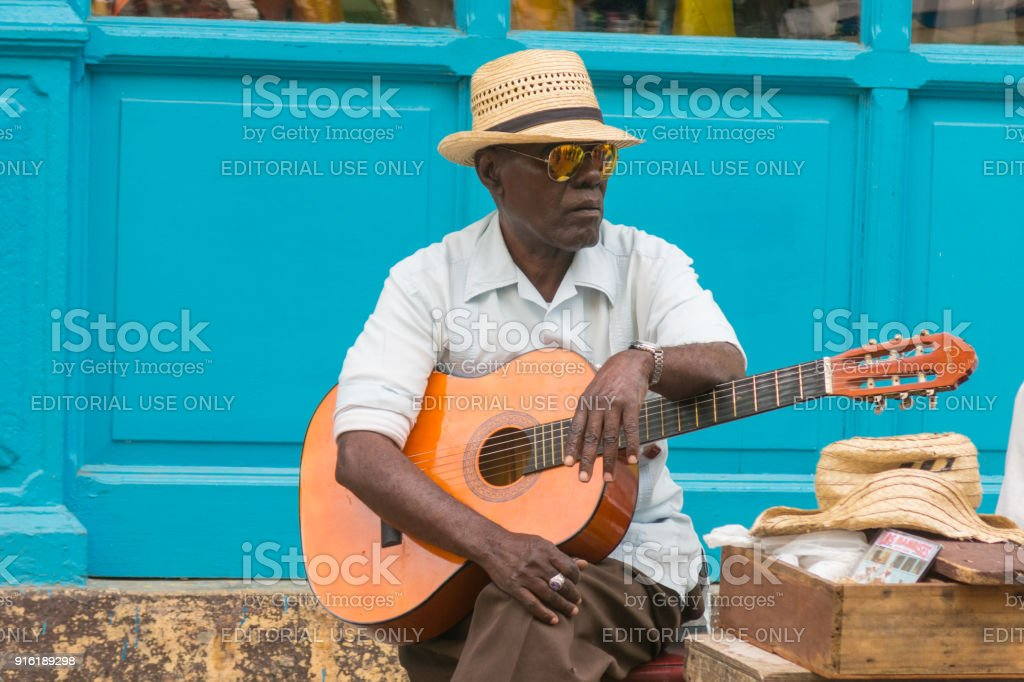 Street musician perform for tourists and tips in Old Havana, Havana, Cuba stock photo