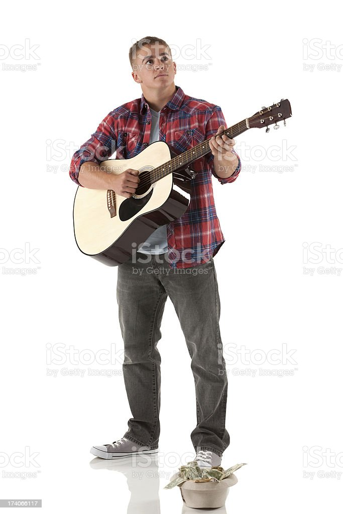 Street musician playing a guitar stock photo