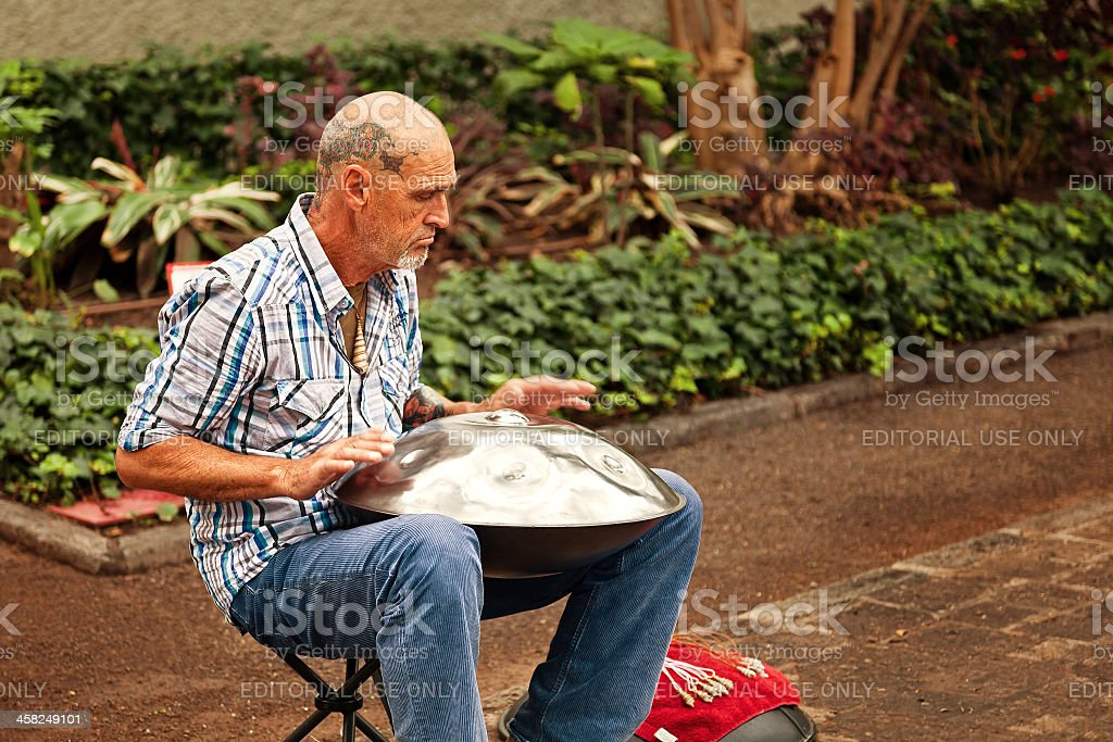 Street Musician Playing a Traditional Instrument called Hang stock photo