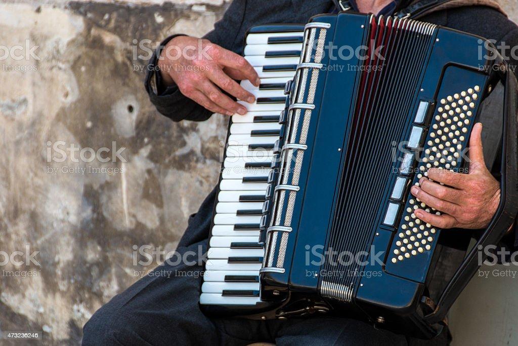 Street musician playing an accordion stock photo