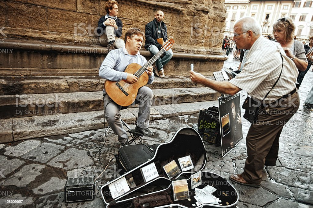 Street  Musician playing guitar  in Florence, Italy stock photo