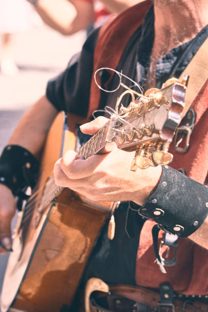 street musician playing mandolin on the streets of a city. vertical stock photo