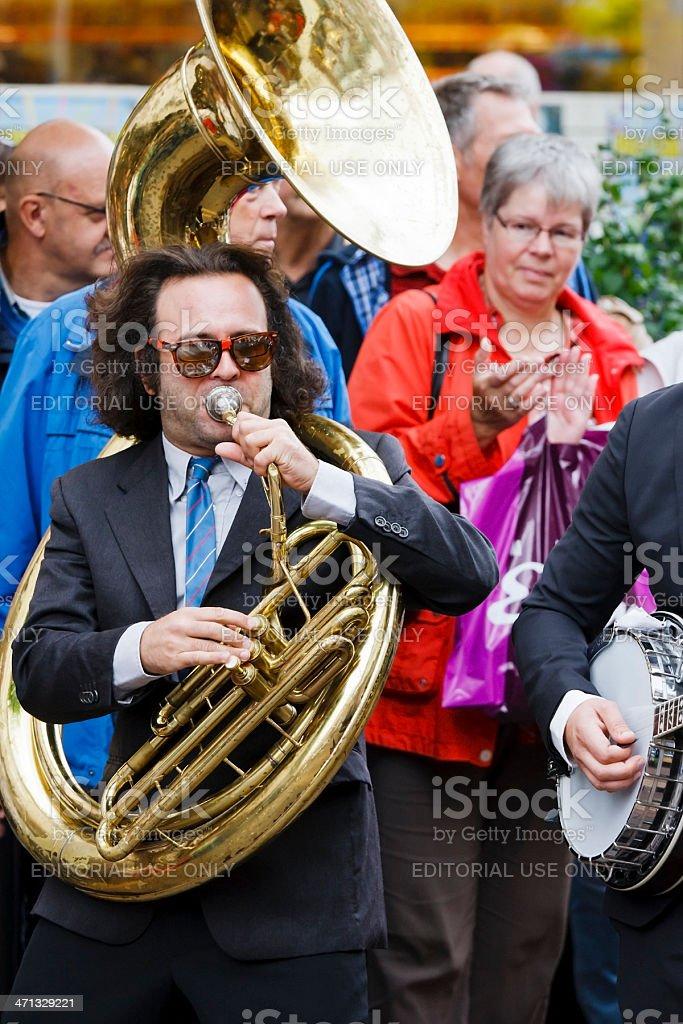 Street musician playing sousaphone stock photo
