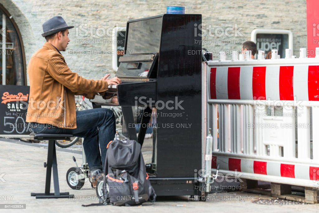 Street musician playing the piano stock photo