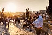 Prague, Czech Republic - April 9th, 2017- Street musician playing violin on Charles bridge in Prague, Czech Republic