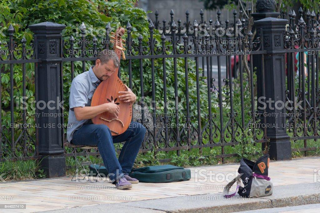 Street musician Ukraine tradition instrument стоковое фото