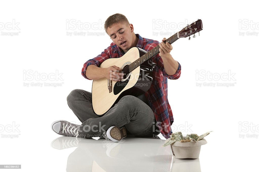 Street musician with a guitar stock photo