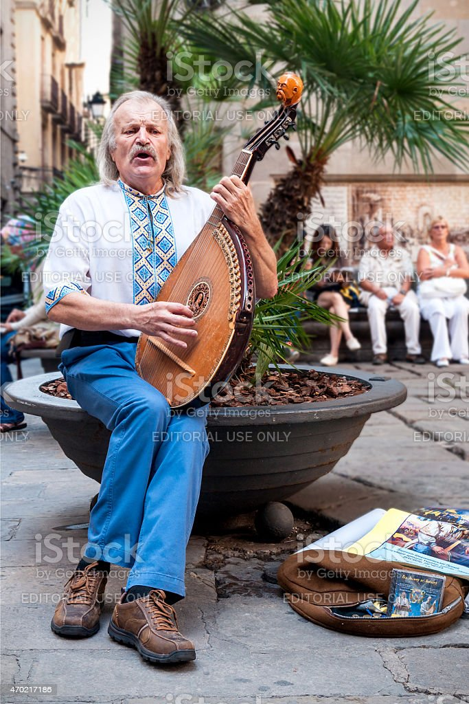 Street musician with lute in Barcelona stock photo