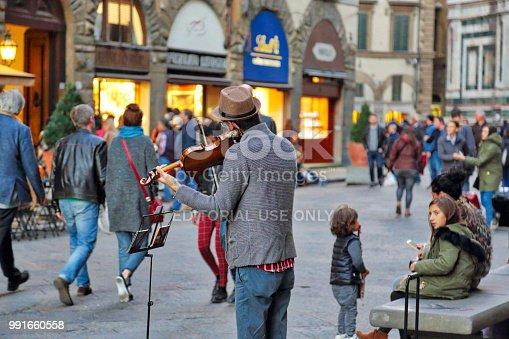 istock Street musicians entertaining tourists near landmark Florence attraction 991660558