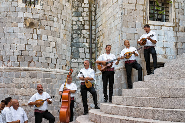Street musicians in medieval costumes singing and playing Dubrovnik Dubrovnik, Croatia - August 20, 2016: Street musicians in medieval costumes singing and playing in the Old town of Dubrovnik, Croatia croatian culture stock pictures, royalty-free photos & images