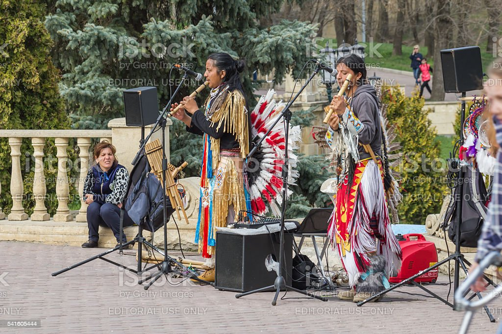 Street musicians in national costumes. stock photo