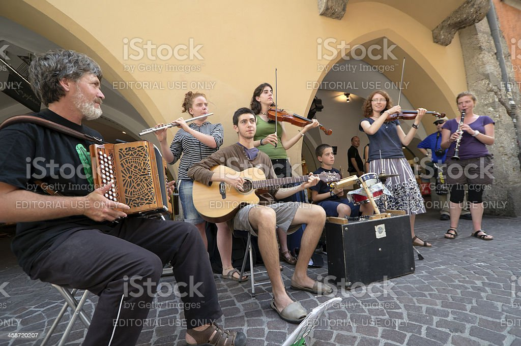Street musicians in old Innsbruck main square royalty-free stock photo