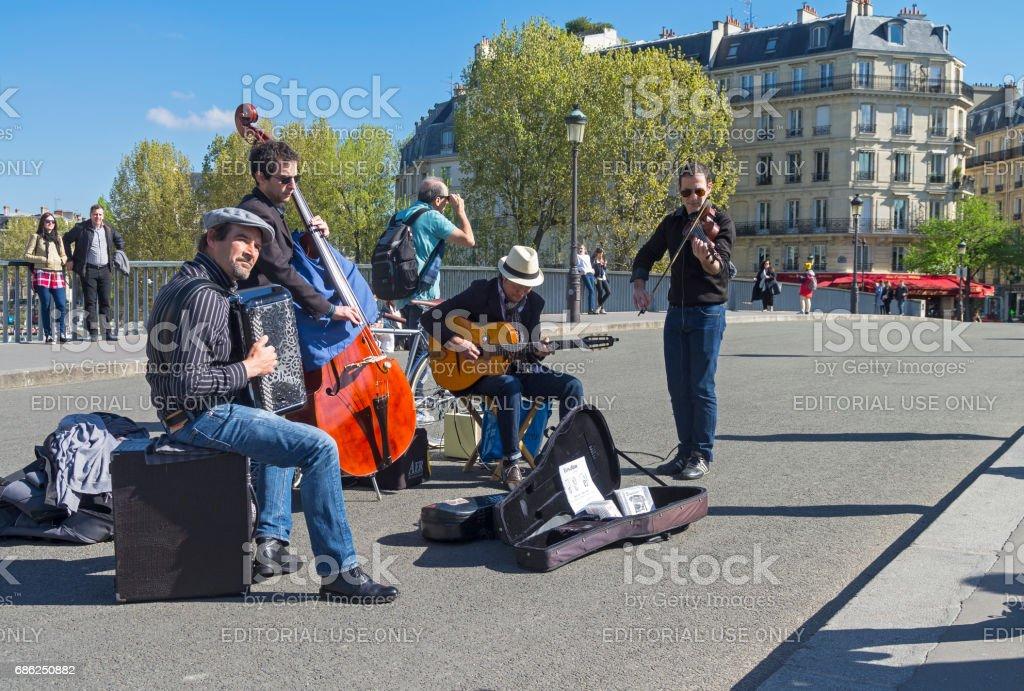 Street musicians. Paris, France. stock photo