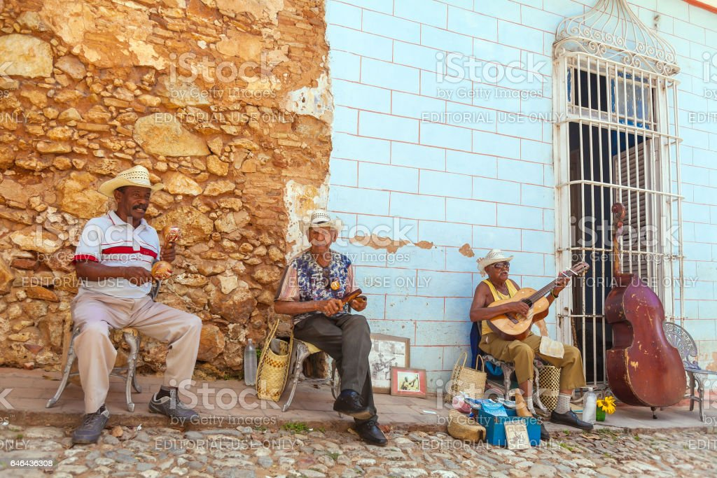TRINIDAD, CUBA - MARCH 30, 2012: Street musicians perform songs for tourists stock photo