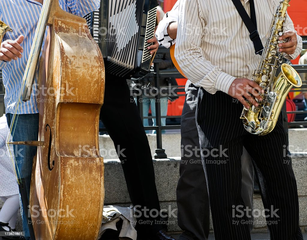 Street musicians playing trumpet and string bass stock photo