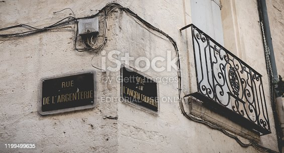 Montpellier, France - January 02, 2019: Street name plate in French - Rue de Argenterie and Rue de Ancien Courier in the historic city center on a winter day