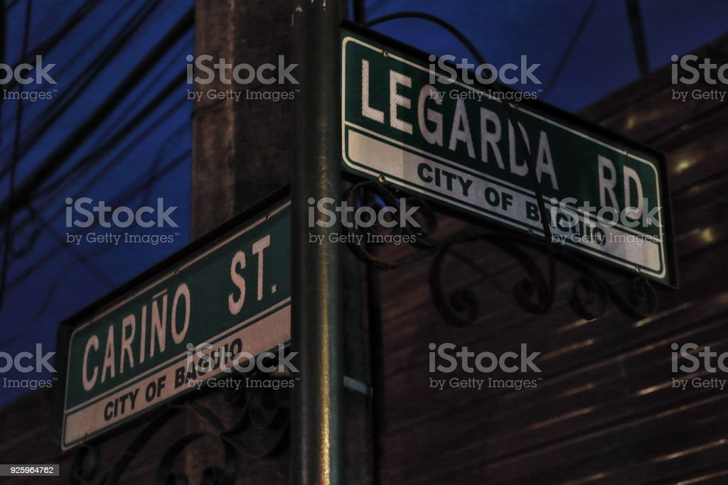 Street name signs-junction of Cariño with Legarda road. Baguio-Benguet province-Philippines. 0257 stock photo