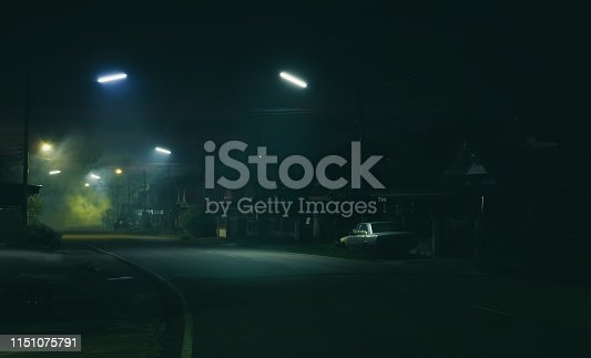 istock Street night scene and smoke background 1151075791