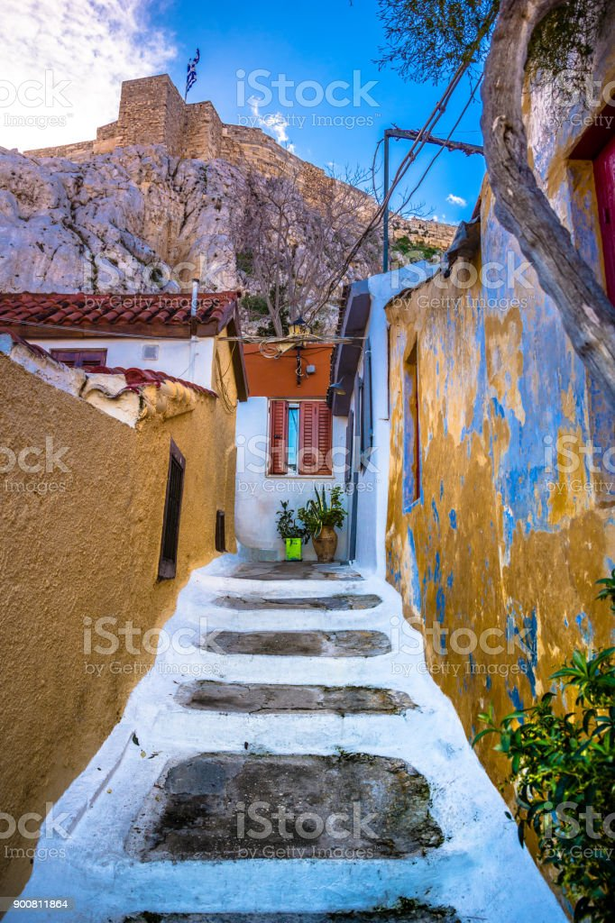 Street of Anafiotika in the old town of Athens, Greece. Anafiotika is district built by workers from the island Anafi. Popular tourist attraction. stock photo