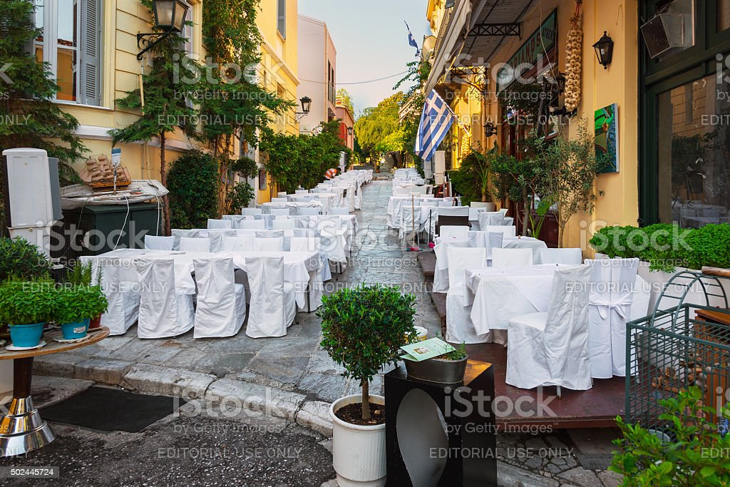 Street of Athens old town with decorated white wedding tables stock photo