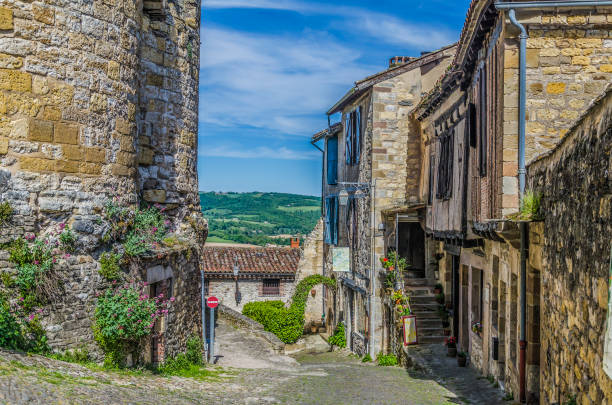 Street of Cordes sur ciel and French countryside stock photo
