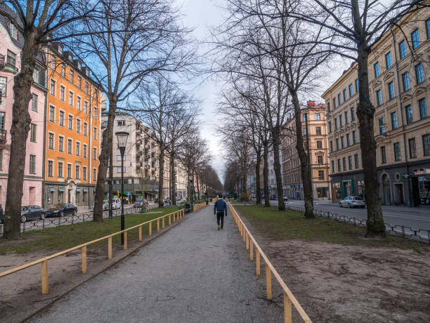 Stockholm, Sweden - April 13, 2020: Street of Karlavägen in the city center of Stockholm. Less people are out on the streets due to the corona virus covid-19. stock photo
