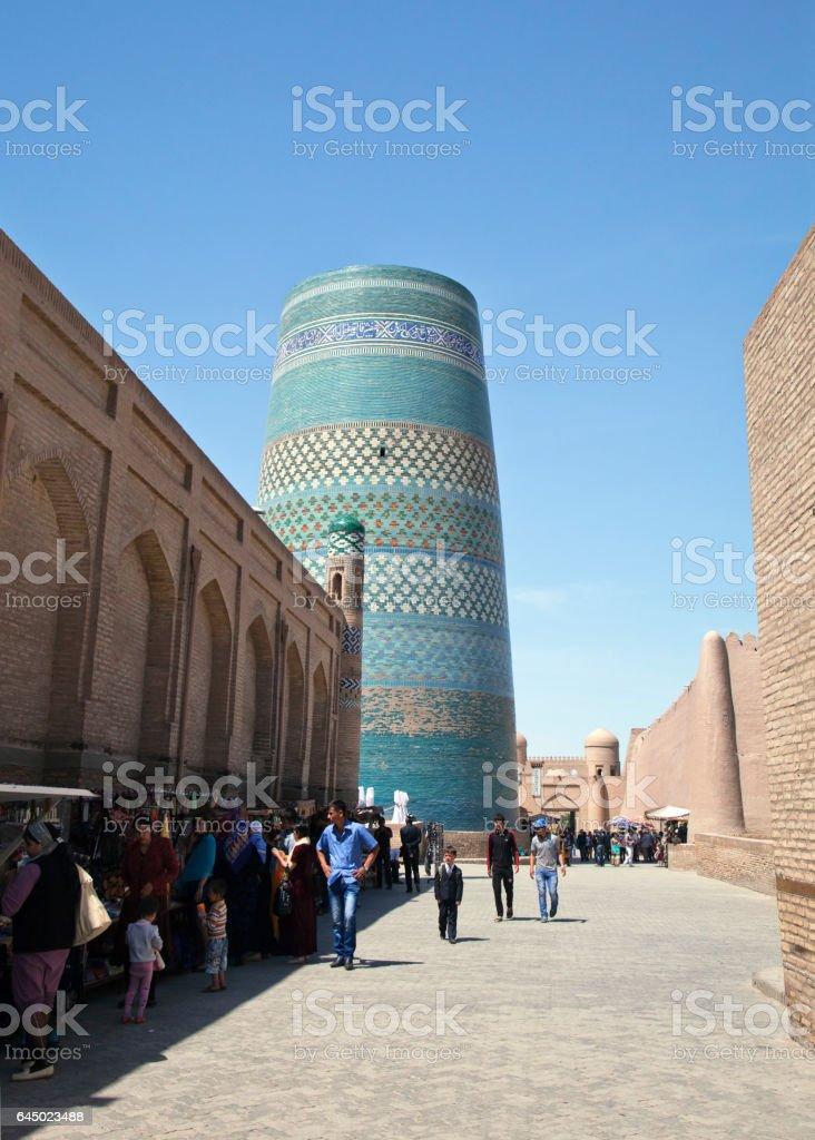KHIVA, UZBEKISTA,N - MAY 01, 2014: Street of Khiva with Kalta Minor Minaret vew stock photo