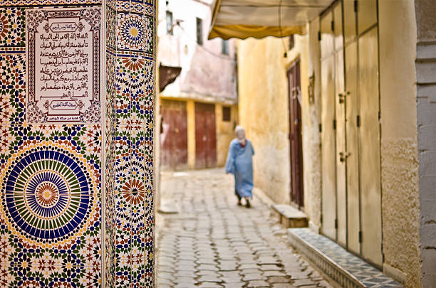 street of meknes with decorating tiles - north africa stock photos and pictures