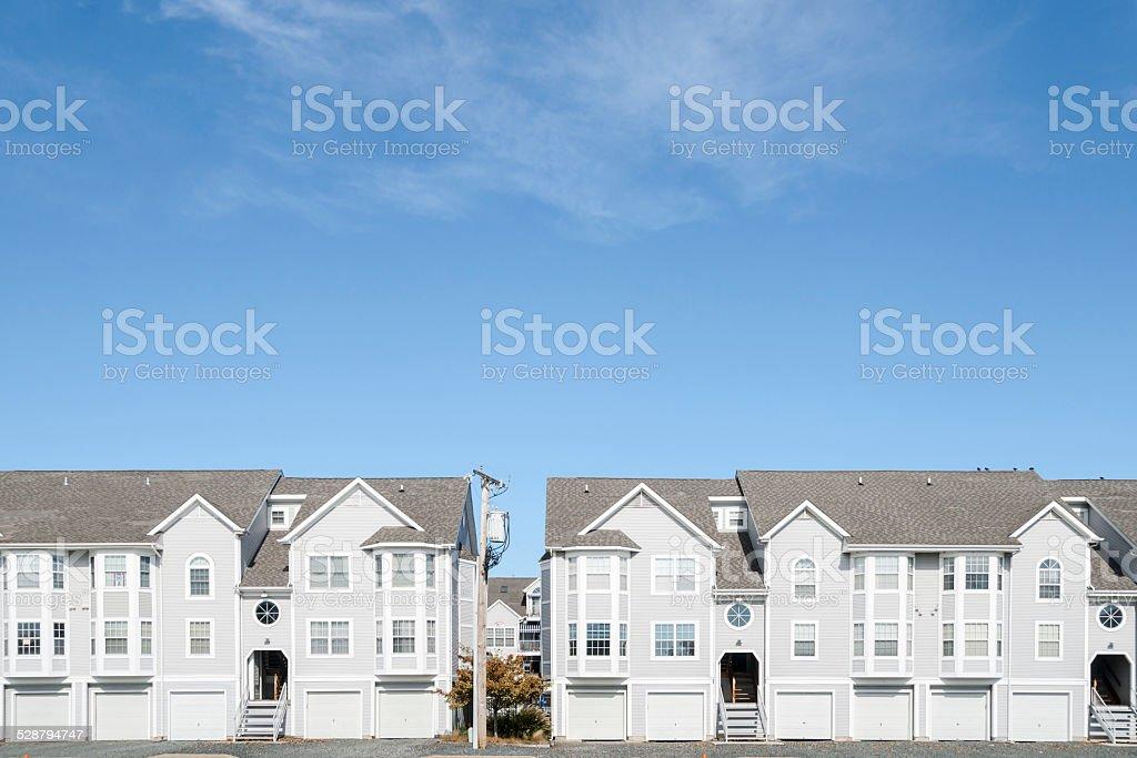 Street of new townhouses. stock photo