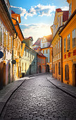 Old narrow street of Prague at dawn