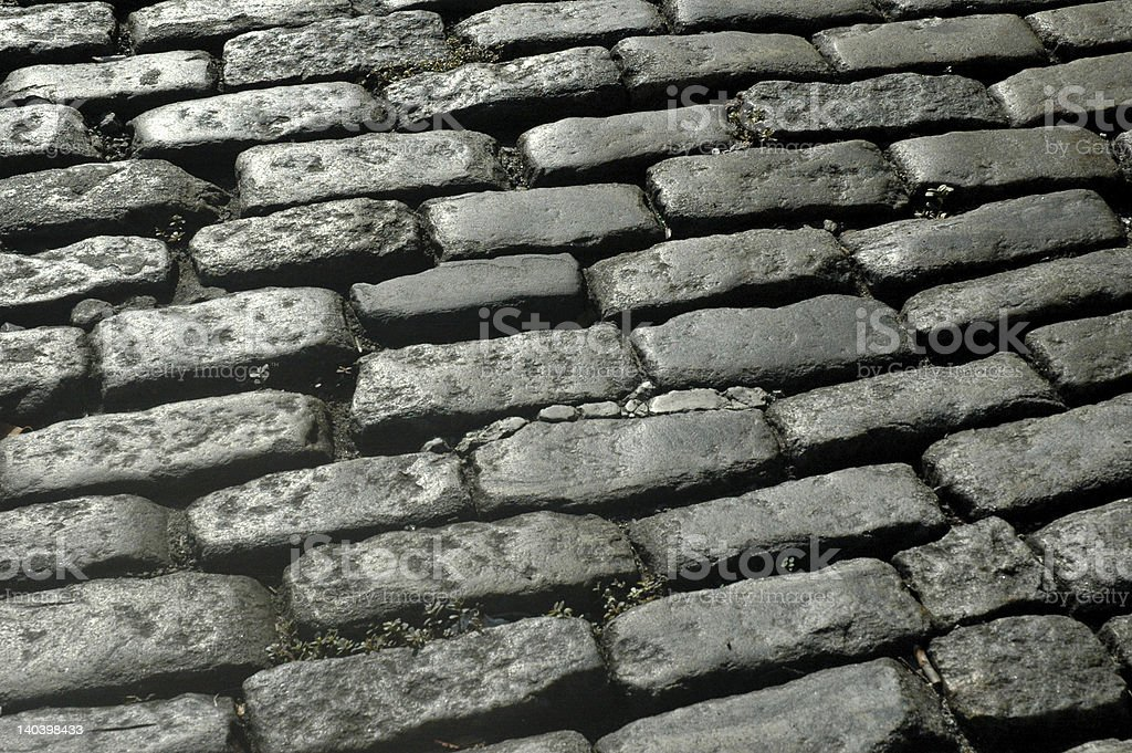 Street of rectangular cobblestones stock photo