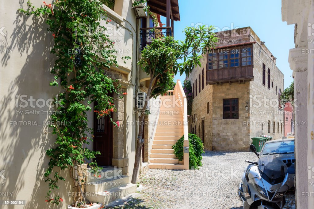 Street of Rhodes town with old houses and narrow streets. stock photo