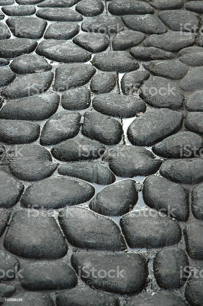 Street of rounded cobblestones stock photo