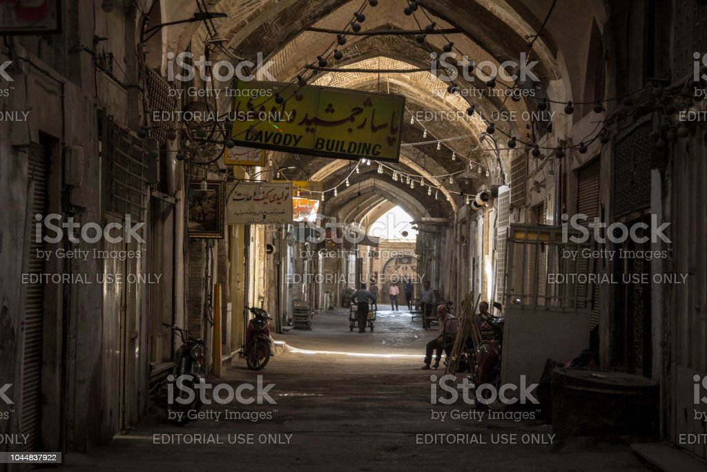 Street of the Isfahan bazar in the afternoon, in a covered alley of the market. Symbol of the Persian architecture, it's a major landmark of the city stock photo