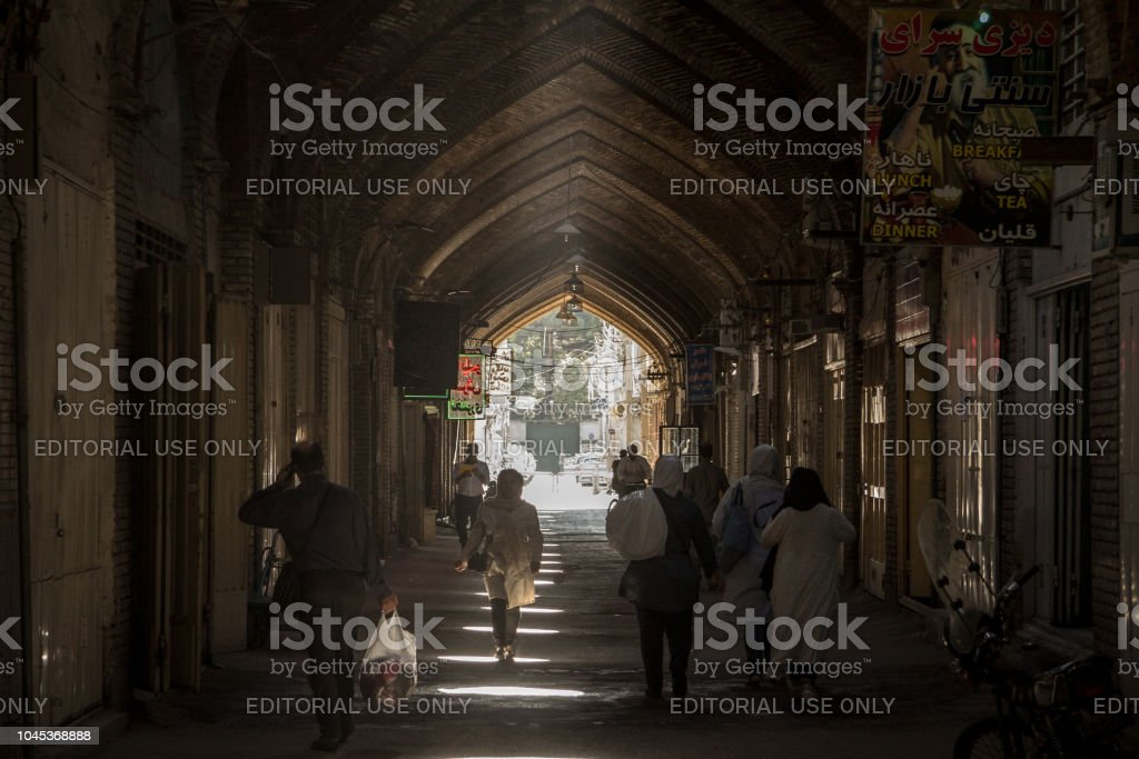 Street of the Isfahan bazar in the evening in a covered alley of the market. Symbol of the Persian architecture, it's a major landmark of the city stock photo