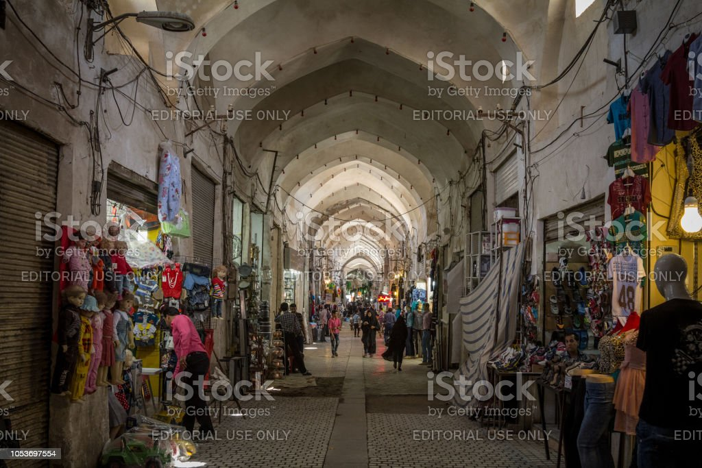 Street of the Kashan main bazar in the afternoon in a covered alley of the market. Symbol of the Persian architecture, it's a major landmark of the city stock photo
