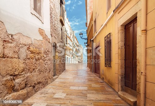 old houses and marble coating in ancient city of Roman Empire of Tarragona in Spain