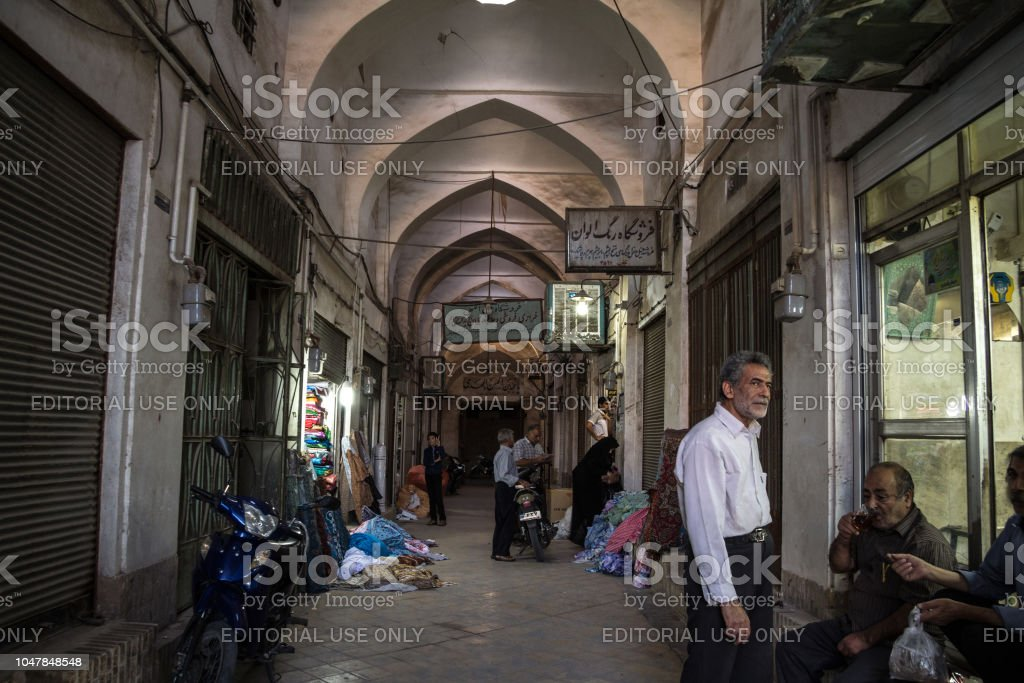 Street of the Yazd bazar in the evening in a covered alley of the market. Symbol of the Persian architecture, it's a major landmark of the city stock photo